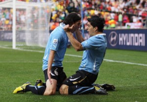 PORT ELIZABETH, SOUTH AFRICA - JUNE 26:  Luis Suarez of Uruguay (R) celebrates scoring with teammate Edinson Cavani during the 2010 FIFA World Cup South Africa Round of Sixteen match between Uruguay and South Korea at Nelson Mandela Bay Stadium on June 26, 2010 in Nelson Mandela Bay/Port Elizabeth, South Africa.  (Photo by Alex Livesey - FIFA/FIFA via Getty Images)