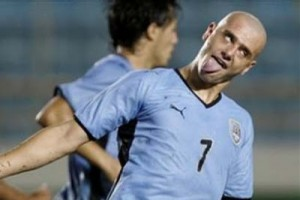 Uruguay's Matias Aguirregaray, right, celebrates after scoring during an under-20 South American soccer championship game against Colombia in Maturin, Venezuela, Monday, Feb. 2, 2009. (AP Photo/Fernando Llano)
